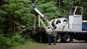 A Blue Ridge crew member pulls line from one of the company's winch trucks.